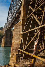 """Moonshine Saran wrapped to a bridge trestle, Portland, OR 2013. © Dave Haworth. (I use the pseudonym """"Lord Murphy"""" on FetLife)."""